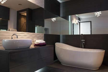 Photo pour Picture of elegant fixture in luxurious dark bathroom interior - image libre de droit