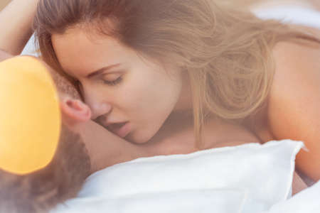 Photo for Close-up of alluring woman kissing male neck - Royalty Free Image
