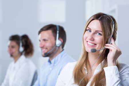 Foto de Group of people with headsets working in call center - Imagen libre de derechos