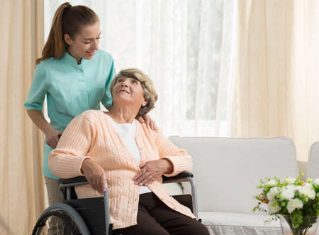 Photo for Nurse discussing with elder patient in care home - Royalty Free Image