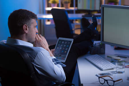 Photo for Man during night shift in office thinking about new idea - Royalty Free Image