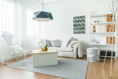 Foto für Trendy furniture in small cozy living room - Lizenzfreies Bild
