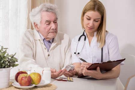 Photo pour Photo of retired man on private medical consultation - image libre de droit