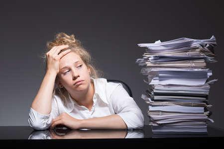 Photo pour Photo of burnout office worker lying on desk - image libre de droit