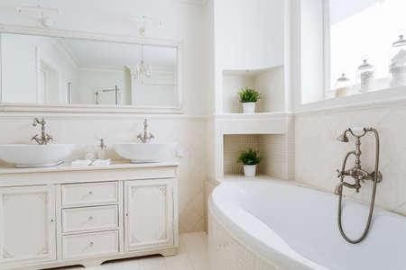 Foto de Light bathroom with two sinks and big mirror - Imagen libre de derechos