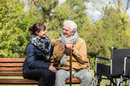 Photo for Elder man and carer in the park - Royalty Free Image