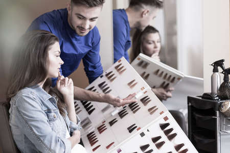Photo for Hairdresser is presenting a pallet of colors - Royalty Free Image