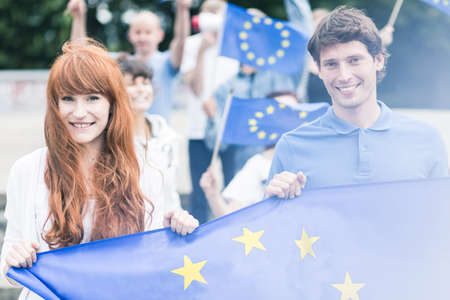 Photo for Picture of young community workers with european union flags - Royalty Free Image