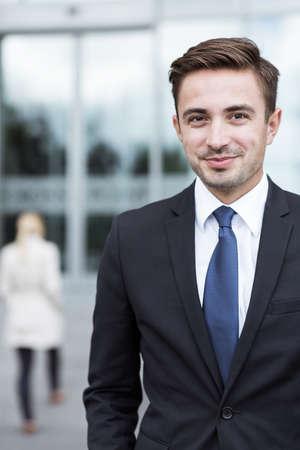 Photo pour Portrait of young confident businessman outside office - image libre de droit