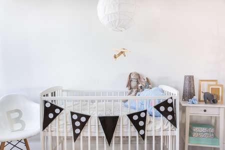 Photo pour Image of white baby cot with decoration - image libre de droit