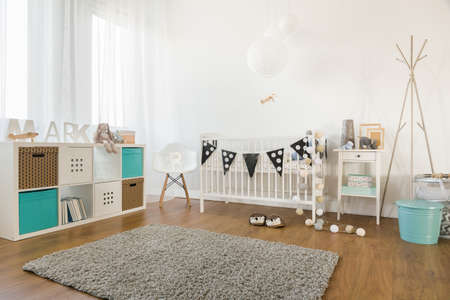 Photo pour Picture of cosy and light baby room interior - image libre de droit