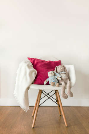 Photo pour Image of white baby blanket and toy on chair - image libre de droit