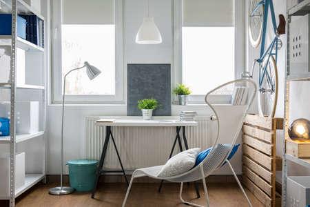 Foto de Small bright studio flat with white furniture - Imagen libre de derechos