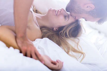 Photo for Young passionate married couple during morning sex - Royalty Free Image