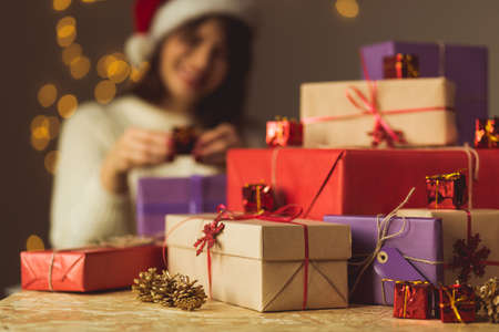Foto de Image of smiling girl opening Christmas presents - Imagen libre de derechos