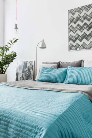 Photo pour Photo of turquoise decorative bedding in new bedroom - image libre de droit