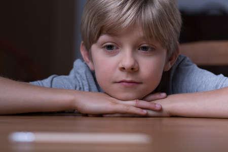 Photo pour Cute blonde boy lying on the table - image libre de droit