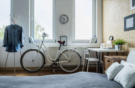 Photo for Trendy white city bicycle in bright bedroom - Royalty Free Image