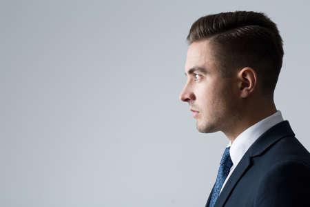 Foto de Profile of young businessperson on gray background - Imagen libre de derechos