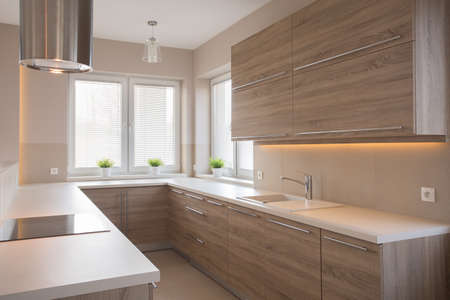 Bright wooden kitchen in beauty luxury house