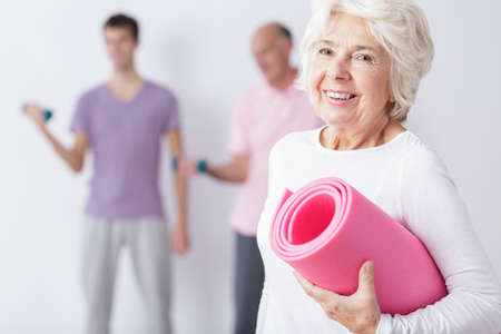 Photo pour Photo of happy elderly woman at gym after training - image libre de droit