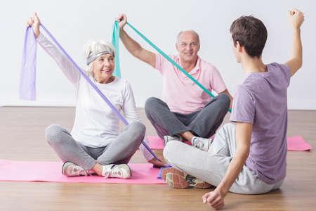 Foto de Image of elderly people do physical exercises for health - Imagen libre de derechos