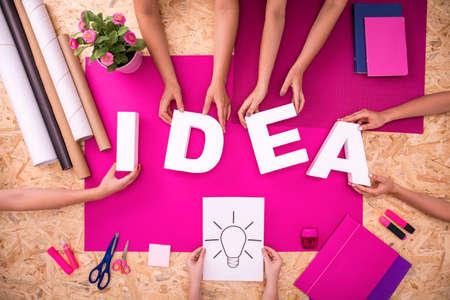 Photo pour Close-up of young people with creative idea - image libre de droit