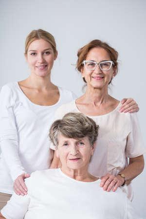 Photo pour Happy family portrait of three beautiful females - image libre de droit