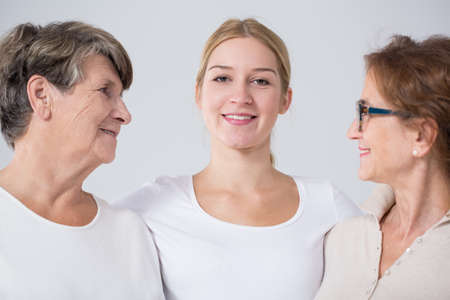 Image of beautiful woman with grandmother and mother