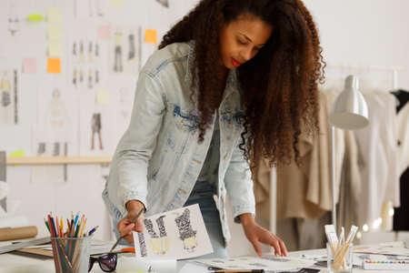 Foto de Picture of fashion designer during work at agency - Imagen libre de derechos