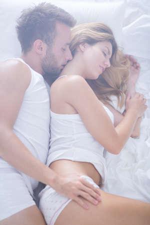 Photo pour Image of romantic couple of lovers lying in bed - image libre de droit