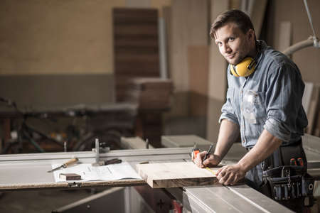 Photo for Horizontal view of man working in private carpentry workshop - Royalty Free Image