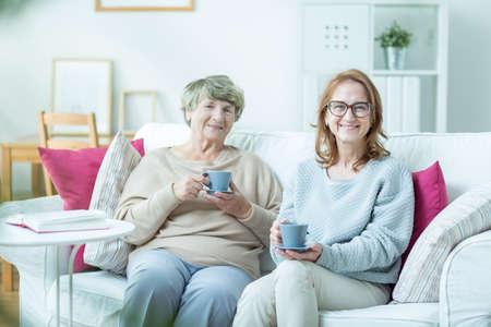 Foto für Middle-aged woman spending time with her elderly mother - Lizenzfreies Bild