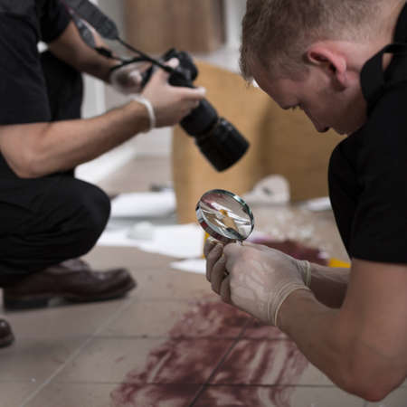 Photo for Police officers working at the murder scene - Royalty Free Image