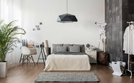Photo pour Interior of white and gray cozy bedroom - image libre de droit