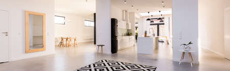 Foto de Panorama of spacious white interior with open kitchen - Imagen libre de derechos