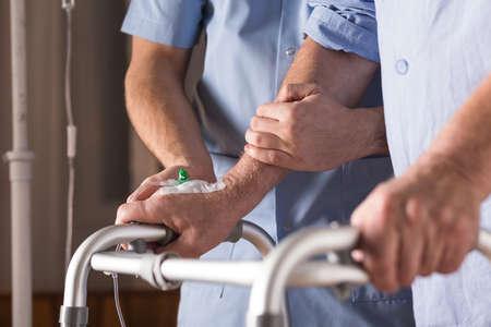 Foto de Close-up of disabled person walking with assistance - Imagen libre de derechos
