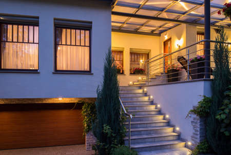 Photo for Modern stylish house with lighted outside stairs - Royalty Free Image
