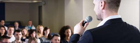 Photo pour Elegant middle aged lecturer talking to students during classes on university - image libre de droit