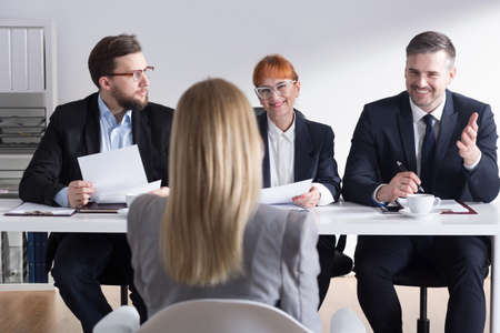 Photo for Three employers interviewing young woman on job interview in corporation - Royalty Free Image