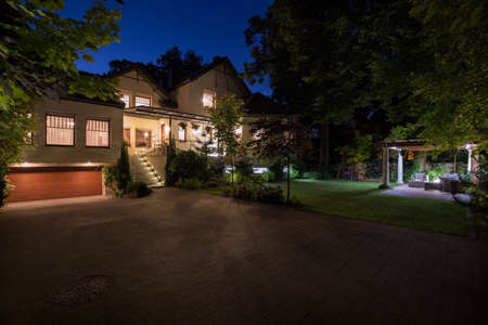 Photo for Photo of new white mansion with large cobbled driveway - Royalty Free Image