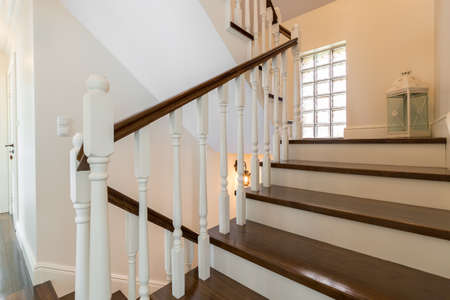 Foto de Classic wooden stairs in stylish storey house - Imagen libre de derechos