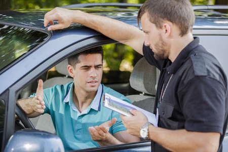 Photo pour Young driver is making an excuse after arrest - image libre de droit