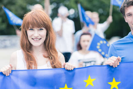 Photo for Young woman with flag of European Union - Royalty Free Image