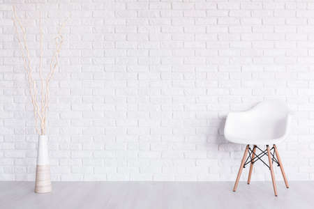 Foto de Shot of a white modern room with a chair and a vase - Imagen libre de derechos