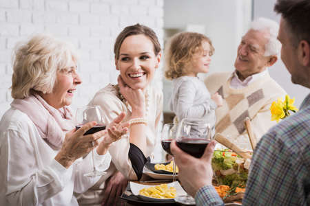 Photo pour Happy multi-generational family gathering during holidays at the table - image libre de droit