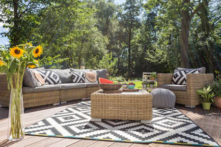 Photo pour Villa patio with stylish rattan furniture and pattern carpet - image libre de droit