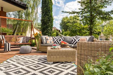Photo pour New design villa patio with comfortable rattan furniture and pattern carpet - image libre de droit