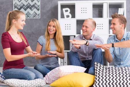 Photo pour Group of young people studying a sign language - image libre de droit