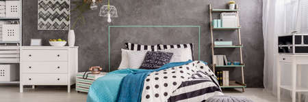 Photo pour Bedroom interior in shades of cyan with marital bed and white decorations - image libre de droit